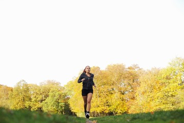 Fitness woman jogging in park