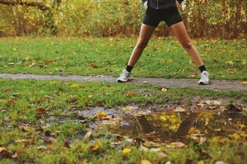 Young woman exercising at park