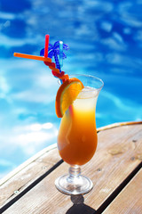 Refreshing coctail near swimming pool on vacation