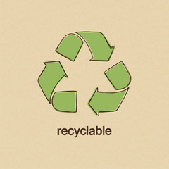 Recycle sign in doodle style over carton paper background
