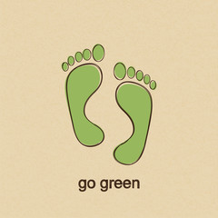 Green human footprints in doodle style over carton paper