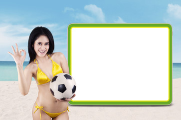 Soccer fans with copyspace at beach