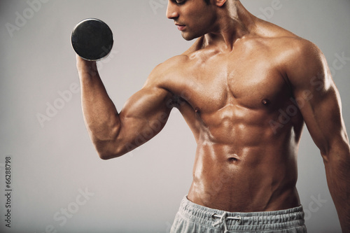 Man working out with dumbbells - 66288798