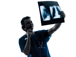 doctor surgeon radiologist on the phone examining lung torso  x-