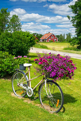 Flower bicycle on Swedish garden