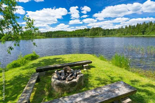 Staande foto Scandinavië Campfire on the lake coast