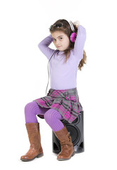 a young girl listening to music on her headphones