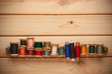 Vintage Background with Sewing kit. bobbins thread
