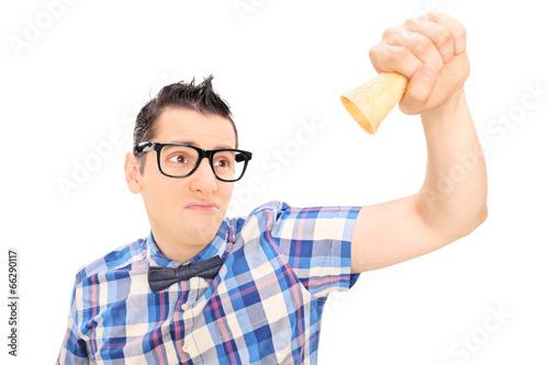Sad man holding an empty ice cream cone
