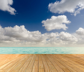Tropical seascape with empty wooden jetty giving a warm relaxing