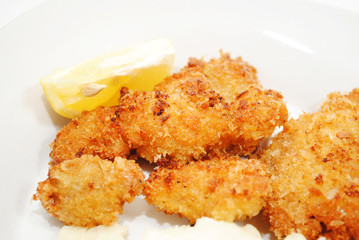 Crispy Fried Catfish Served with a Lemon Wedge