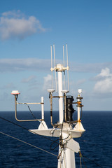 Old White Satellite Equipment on Blue Sea