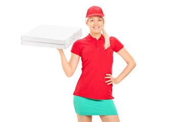 Delivery girl holding two boxes of pizza
