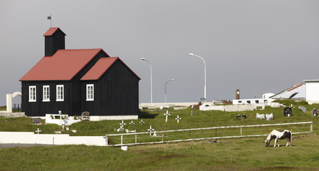 Iceland. Reykjanes Peninsula. Utskalar church and cemetery.