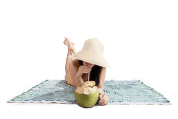 Woman drinking a coconut water isolated