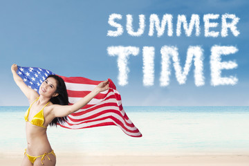 Woman holding american flag enjoying summertime