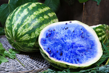Blue watermelons on wicker tray