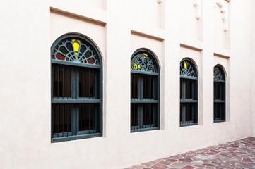 Row of arabian artistic windows in Doha, Qatar