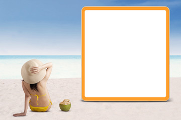 Woman in bikini with empty board 1