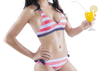 Woman in sexy bikini holding fresh drink