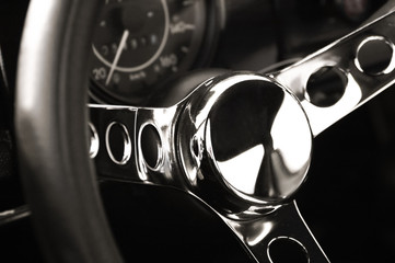 chromed luxury sportscar steering wheel