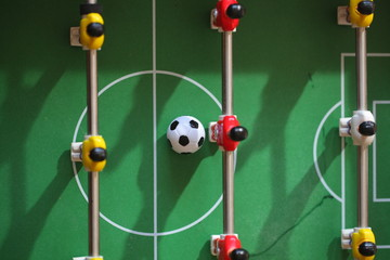 football - board game with players, soccer ball and green field