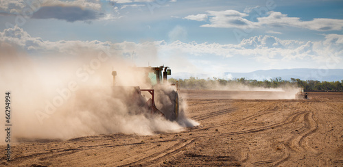 Tractor plowing dry land - 66294994