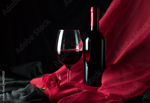 bottle and glass with red wine - 66295321