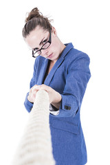 Businesswoman pulling rope - conceptual image