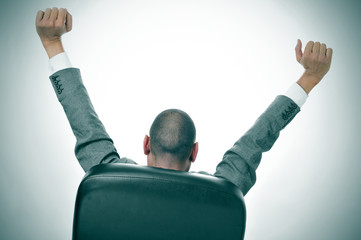 businessman stretching in his office chair