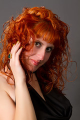 red-haired girl in a black dress
