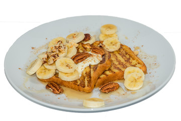 French toast with bananas on white