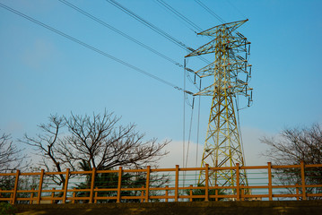 power tower and transmission lines by the blue sky