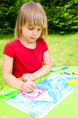 Child drawing outdoors