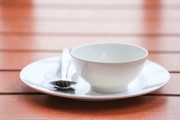 plate with spoon on wooden table