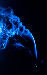 flowing blue smoke on a black background