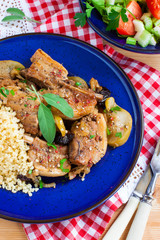 grilled pork ribs with apples, prunes and bulgur