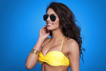 Beautiful woman wearing fashion glasses in summer time