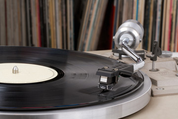 Turntable with vinyl records in the back