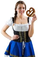 Pretty oktoberfest girl holding pretzel