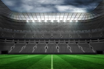 Empty football stadium under clouds
