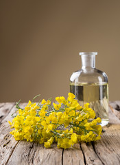 Rape flower on wooden table
