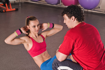 Fitness club woman with trainer