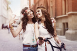 Boho girls walking alley of city poster