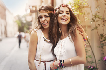 Funny faces of hippie female friends