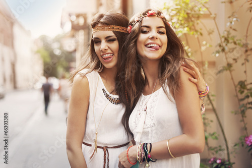 Funny faces of hippie female friends - 66303380