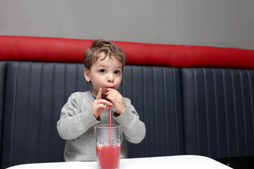Child drinking fruit drink