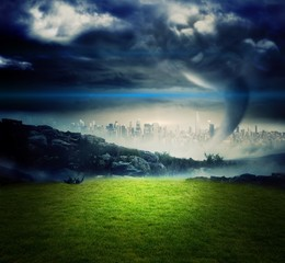 Tornado over city and moutains