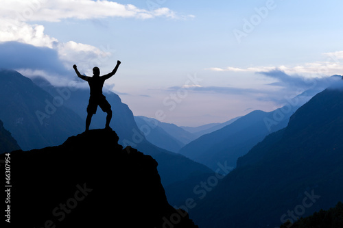 Man hiking success silhouette in mountains - 66307954