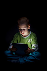 Boy holding tablet